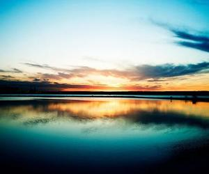 sunset, sky, and water image