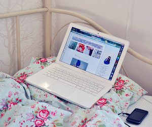 bed, laptop, and flowers image