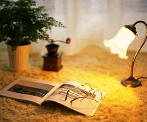 book, glasses, and lamp image