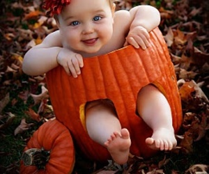 baby and pumpkin image