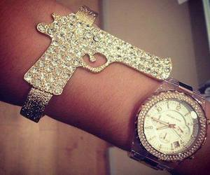 watch, gun, and accessories image