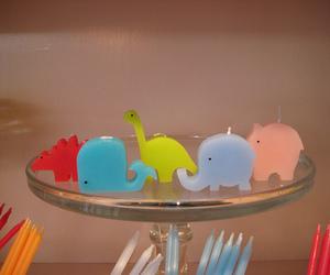 candles, dinosaur, and elephant image