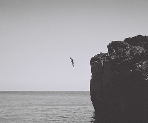 jump, sea, and black and white image