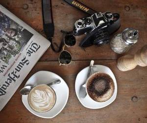 coffee, camera, and newspaper image