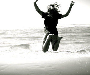 girl, jump, and ocean image