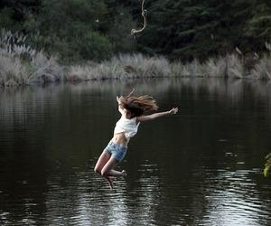 girl, lake, and jump image