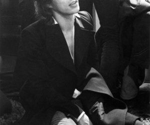 mick jagger, the rolling stones, and black and white image