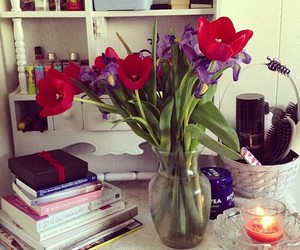 flowers, books, and candle image