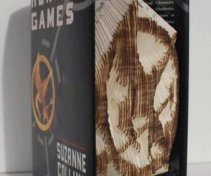 the hunger games, mockingjay, and book image
