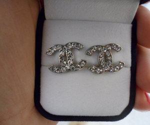 chanel logo earrings image