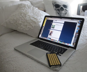 laptop, bed, and white image
