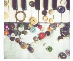 buttons, piano, and polaroid image