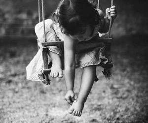 child, black and white, and swing image