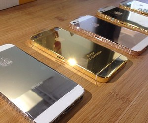 iphone, gold, and silver image