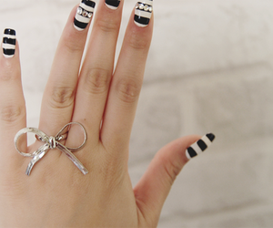 nails, ring, and bow image
