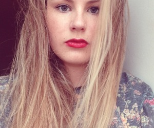 blonde, red lips, and serious image