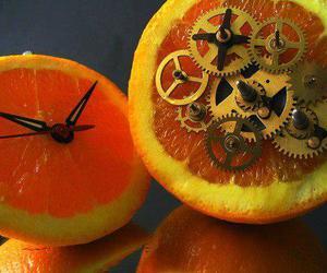 clockwork orange, orange, and clock image
