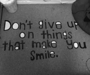 quote, smile, and don't give up image