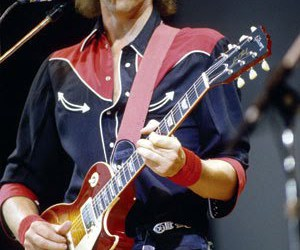 dire straits, mark knopfler, and money for nothing image