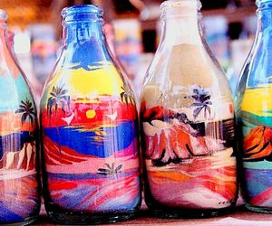 bottle, sand, and art image