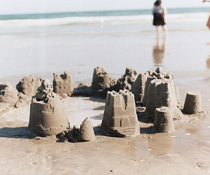 beach and sandcastle image
