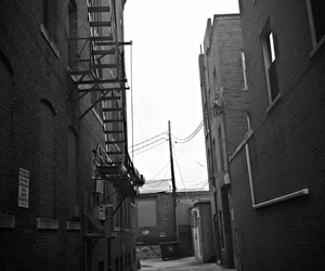 alley, pole, and black and white image