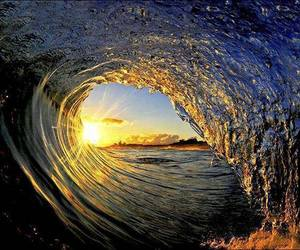 waves, sun, and water image