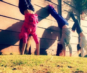 girls, handstands, and three image