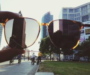 city, glasses, and sun image
