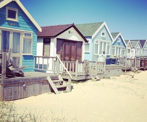 beach, sun, and cabins image