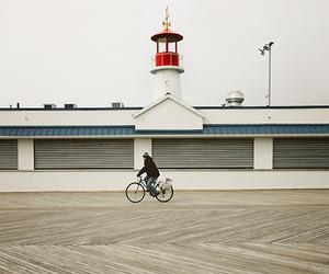 bike, lighthouse, and man image