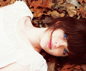 girl, blue eyes, and leaves image
