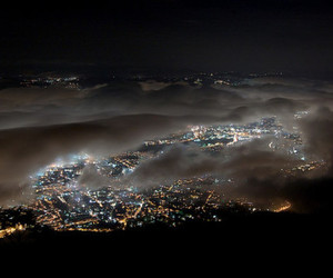 city, light, and clouds image
