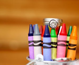 crayons, engagement ring, and wedding band image