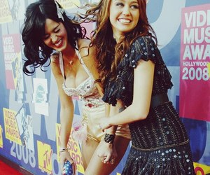 miley cyrus, katy perry, and friends image