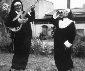 nun, guitar, and black and white image