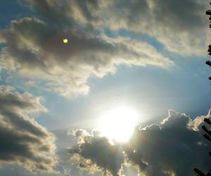 cloudy, sun rays, and clouds image