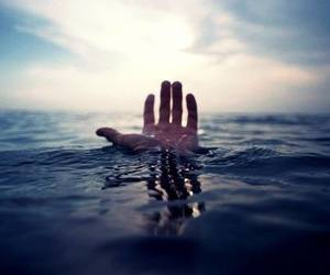 hand, water, and ocean image