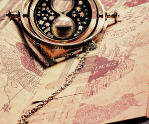 harry potter, time turner, and marauders' map image