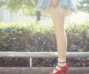 girl and red shoes image