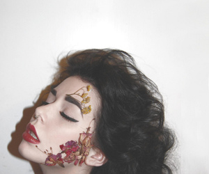 curly hair, face painting, and flowers image