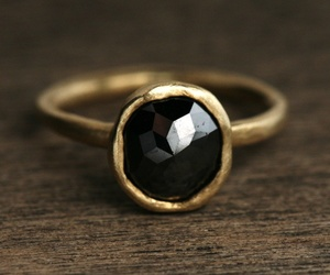 ring, black, and gold image