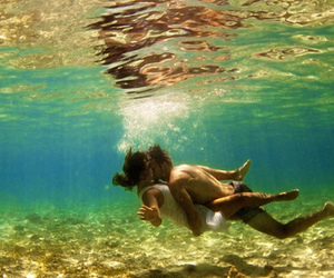 couple, kiss, and swimming image