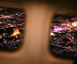 light, city, and plane image