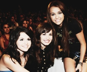 miley cyrus, selena gomez, and demi lovato image