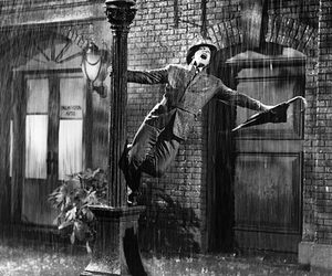 black and white, rain, and Singing In The Rain image
