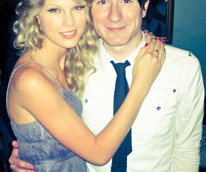 Adam Young, Taylor Swift, and couple image