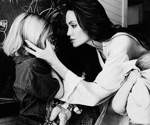 Angelina Jolie, mother, and child image
