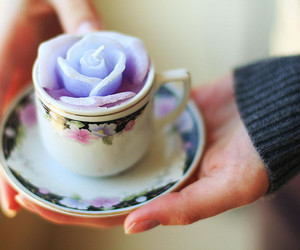 candle, cup, and flower image