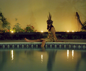 feathers, mask, and pool image